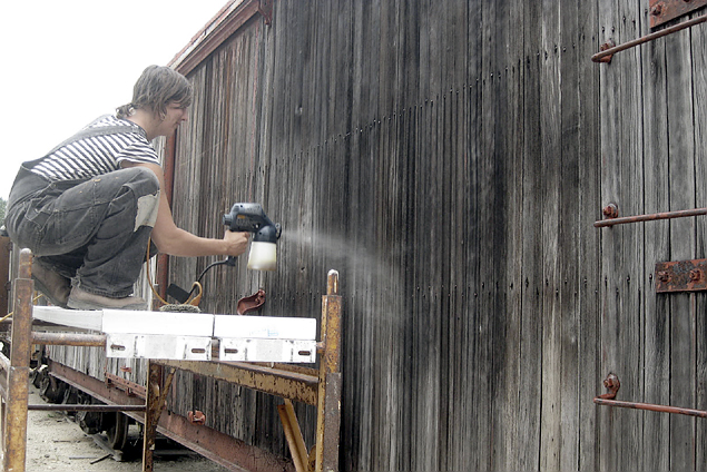 volunteer spraying boxcar